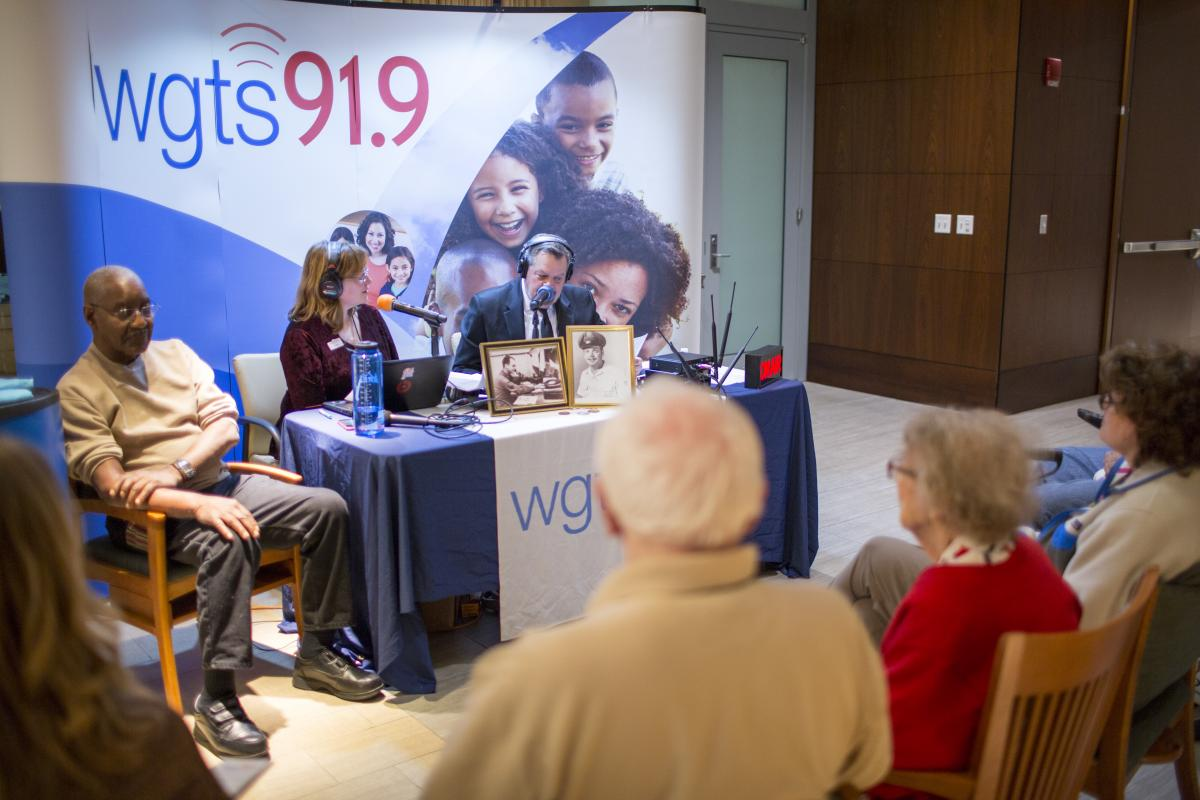 "1.	Johnny Stone and Becky Alignay get ready to interview Sgt. 1st Class Theodore Wilson in front of a studio audience in the ""Hall of Honors"" at the Armed Forces Retirement Home in D.C."