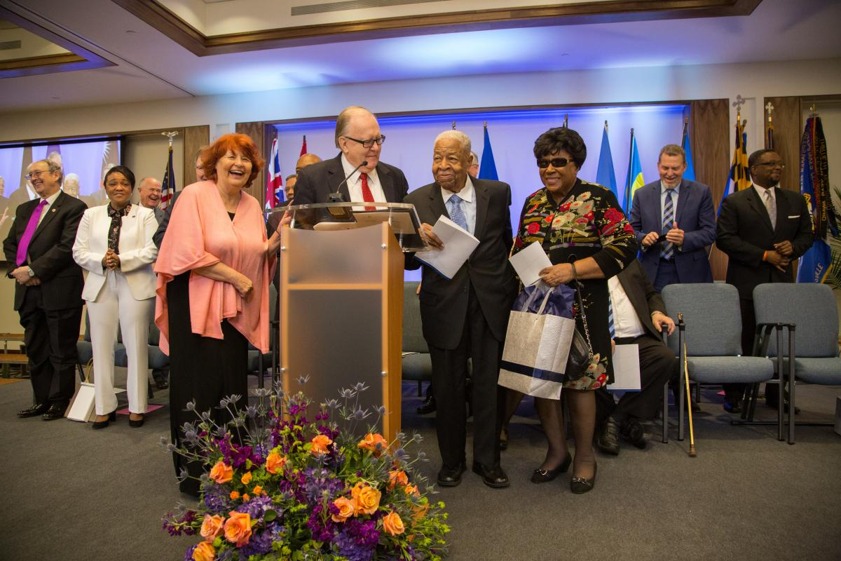 Daniel R. Jackson, NAD president, and wife Donna Jackson, present Charles E. Bradford, first and former NAD president, and wife Ethel Bradford with gifts during the NAD headquarters' dedication program on Oct. 26, 2017. Photo by Pieter Damsteegt