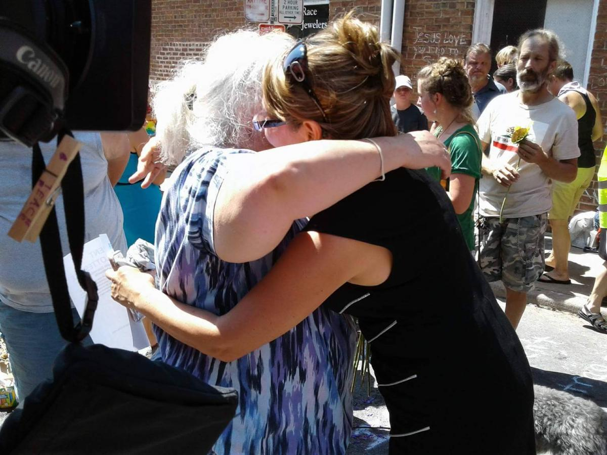 Claudia Pretell from Charlottesville Spanish church hugs Susan Bro.
