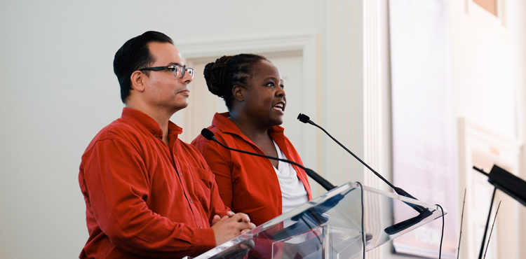 Jose Cortes Jr, an associate ministerial director of the North American Division, and Celeste Ryan Blyden, a vice president at the Columbia Union Conference, lead worshippers in a prayer of commitment during the August 19 joint worship service in Charlottesville, Va.