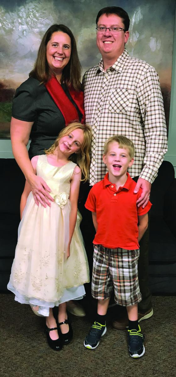 Pastor Heather and Eric Crews pose for a family picture with Molly and Owen.