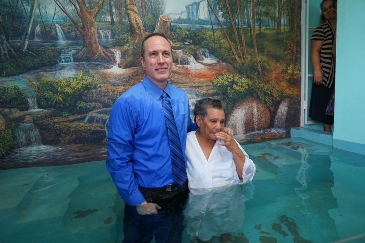 David Klinedinst, evangelism director and trip coordinator, baptizes a woman who attended the weeklong series.