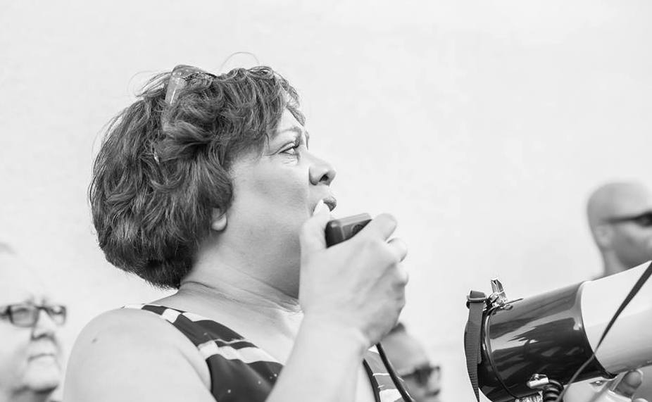 Debra Anderson speaks at a march where a thousand Adventists gathered. | Photo by Richard Gordon