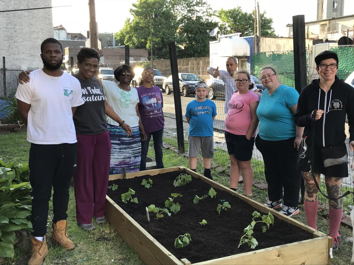 Allegheny East Conference's Mizpah church in Philadelpha provides a weekly grocery distribution, clothing and shoe ministries and a garden for community members (some pictured.)