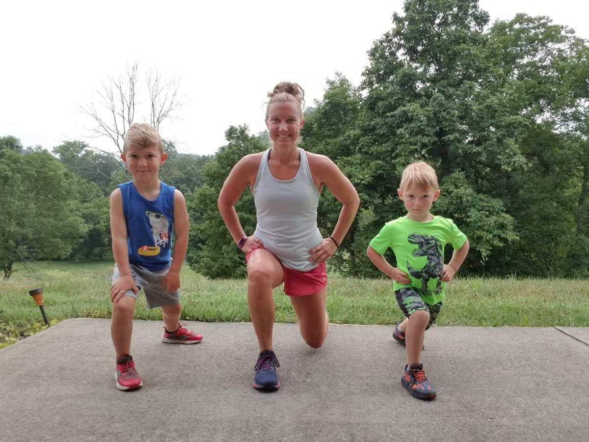 Lukas and Jakob Wagner assister their mother, Keri, in an exercise class on Facebook