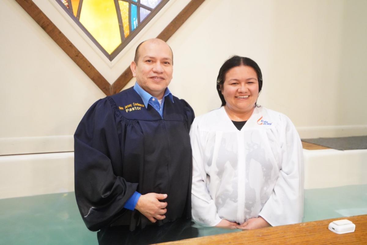 Pastor Julian Tinoco from New Jersey Conference's Edison Spanish church baptizes Luz Pino.