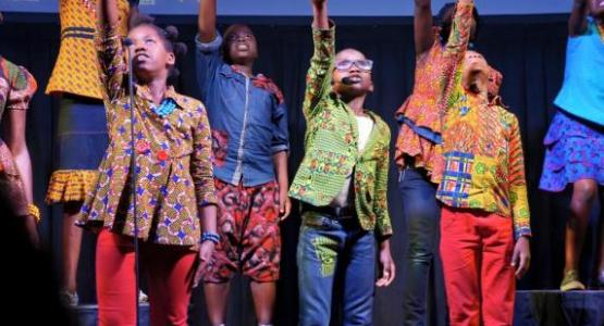 Youth from the Watoto Children Choir, a Christian ensemble from Uganda made up of orphans or kids living in difficult situations, sing songs of God's love to members at the Columbus Central church.