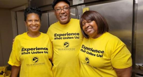Gale Walker, George Jones and Karen Jones have a wonderful experience serving breakfast to 67 women and children at a domestic violence shelter