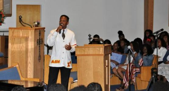 At the back-to-school revival, alumnus Garnett Adams ('10) speaks to PFA students about how God saved him during his incarceration.