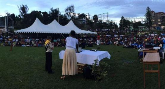 Dillon Smith, 12, speaking to about 1,000 people at a park in Karongi, Rwanda, on Sunday evening. (Jackie O. Smith) via Adventist Review