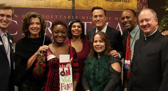 Afternoon show host Tom Miner and morning show host Jerry Woods pose with winners who won a chance to meet Michael W. Smith, Amy Grant and musical director David Hamilton.