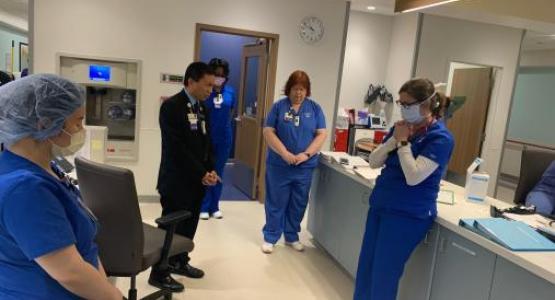 Adventist HealthCare workers pray during the Coronavirus pandemic