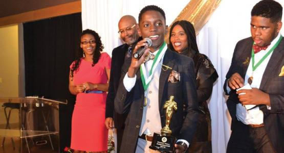 Freshman William Mattox accepts his first place award during PFA's Ambassador Awards program.