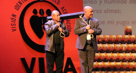 Armando Gomez, a member of the New Jersey Conference's Bridgeton Spanish church, and Carlos Torres, the conference's Personal Ministries director, illustrate one of Alejandro Bullón's spiritual points during the Viva GPS Caravan stop at the Landis Theater in Vineland, N.J.
