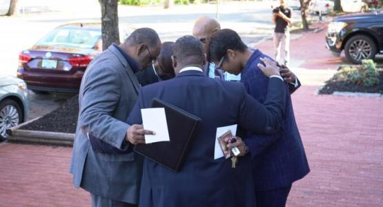 Capitol Hill Counseling and Resource Center Board Members pray before the grand opening.