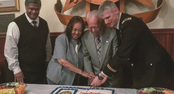 Sendry O. Pittman, Sr. (center), his wife, Doris, and Lieutenant Colonel Vincent B. Myers, commander of the McDonald Army Health Center, celebrate the newly named volunteer program.