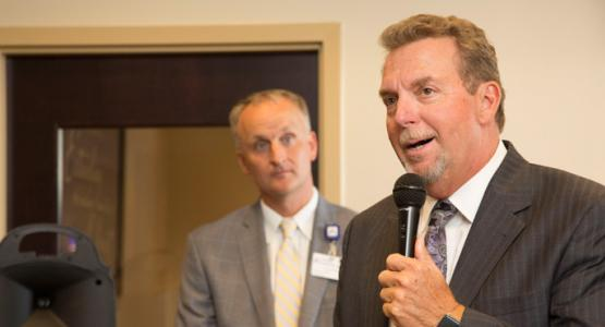Columbia Union Conference President Dave Weigley, chairman of the Adventist HealthCare Board of Trustees, delivers remarks at this summer's grand opening of Adventist HealthCare's new urgent care center in Laurel. This is the organization's third urgent care center in the region. Looking on is Adventist HealthCare President & CEO Terry Forde.