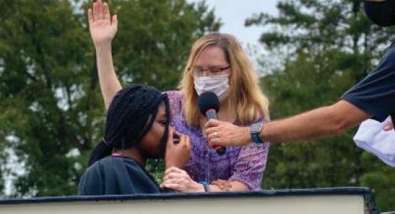Debbie Rivera, associate pastor of the Ellicott City church, baptizes Meghan Stewart into the church.