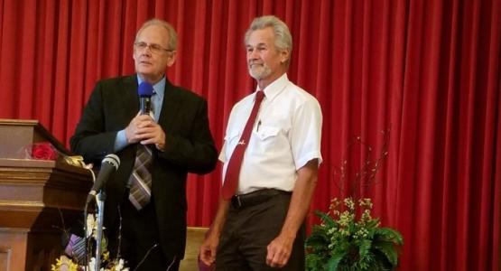 Jim Buchanan (right), pastor of the Cumberland/Frostburg church district, welcomes Don Kelly, a former Mormon, as the newest member of the Frostburg church.