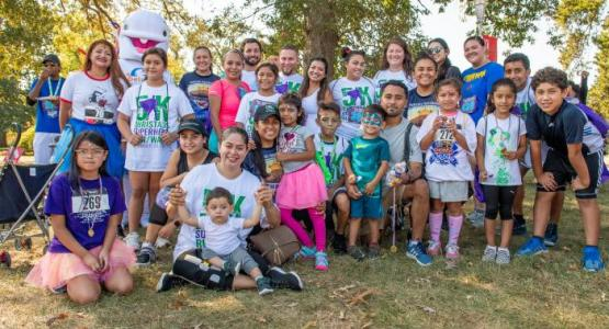 Members of the Langley Park Spanish Seventh-day Adventist Church (Some were volunteers, some ran) gather at the race.