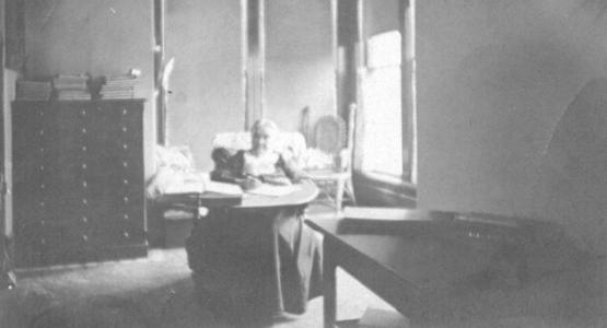 This photograph of Ellen White at her Elmshaven writing desk may have been taken by Charles L. Taylor or Lucy Brown Taylor during the years they lived near the St. Helena Sanitarium. Charles Taylor served as Sanitarium chaplain at the time that Ellen White moved to Elmshaven in 1901. Photograph from the Taylor Family Collection (PUC.MSS.096).