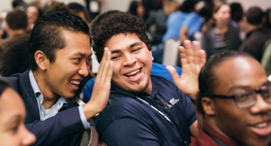 Ro Sang Puia, Chesapeake Conference's youth pastor for the Eastern Shore, and Kevin Jimenez, a member of the Pennsylvania Conference's Kennett Square (Pa.) Hispanic Company, enjoy a young adult summit activity.