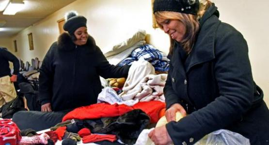 Mt. Olivet members sort clothes for homeless individuals, as the church became a Code Blue winter station due to the freezing tempartures.