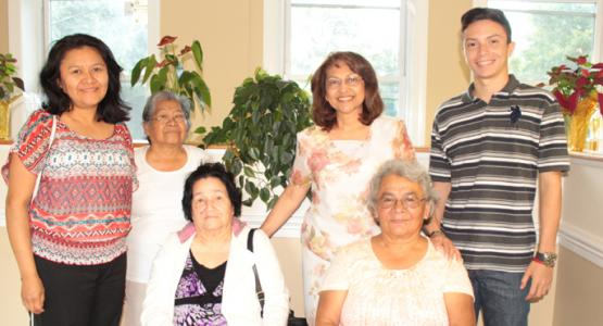 Sayhils Fuentes (middle) poses with members of the Arlington church at the church's grand opening.