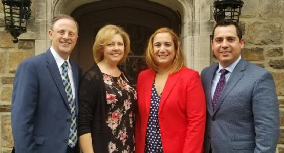 Gary Gibbs and his wife, Sherilyn, welcome Carlos and Liz Charnichart to the Pennsylvania Conference team.