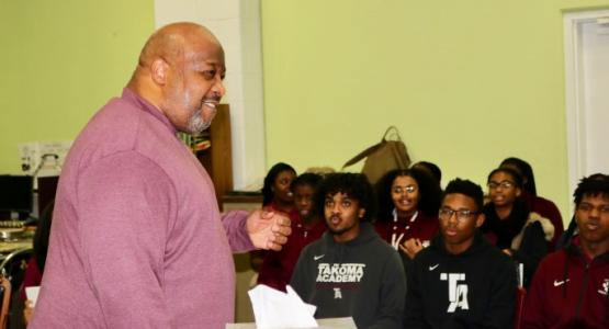 Stacey Gibbs, a composer and arranger of spirituals, shows the TA chorale a different arrangement to one of his songs.
