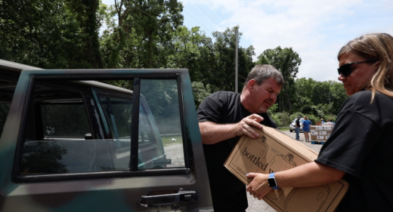 Grandview Hospital employees worked with employees from the Harrison Township Police office (pictured right) and members from an area church in Northridge to provide water to impacted area residents.