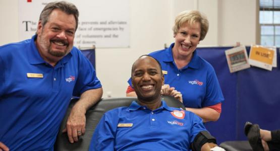 Jerry (center), pictured with Johnny and Stacey, donates blood during the blood drive.