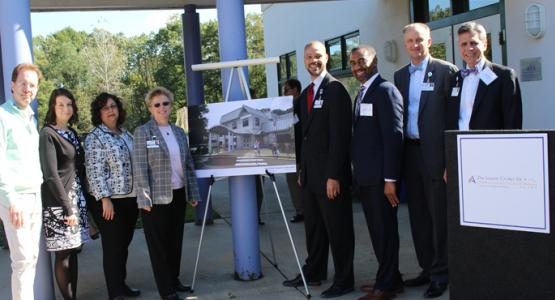 From left to right are Dr. Jimmy Venza, executive director of the Lourie Center for Children's Social & Emotional Wellness; Jill Brown, director of the Parent-Child Clinical Services Program; Jill Ginsburg, Lourie Center's contract manager for the Montgomery County Infants and Toddlers Program; Melanie Jewell, administrative director of the Lourie Center;  Marcel Wright, vice president of behavioral health services for Adventist HealthCare Shady Grove Medical Center; David Daniels, chief operating officer f