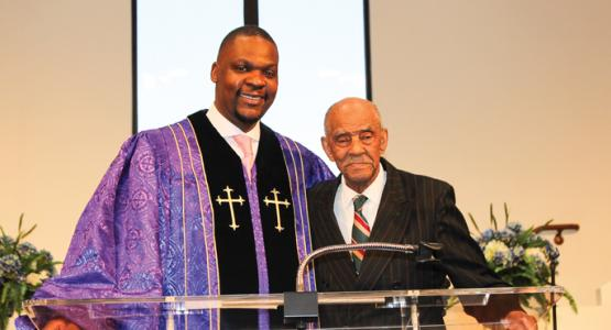 "Mackenzie Kambizi, pastor of the Ethan Temple church, celebrates member Benjamin ""Bennie"" Grissom's 104th birthday and acknowledges his community work with the Jefferson Township Board of Trustees."