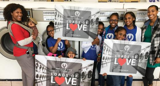 """Members of Allegheny East Conference's Miracle City church in Baltimore provide """"Loads of Love"""" (free laundry) to members of the community."""