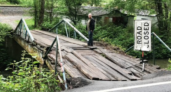 A flash flood in 2015 destroyed this bridge, making it nearly impossible for 13 Pigeon Creek families to get access to food and medical care.