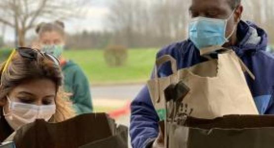 New Hope Adventist church members Tina Pillai and Timothy Atolagbe load groceries that will be taken to LARS