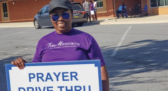 Church member and praise leader Ellen Boakye-Dankwa invites drivers for a quick prayer.
