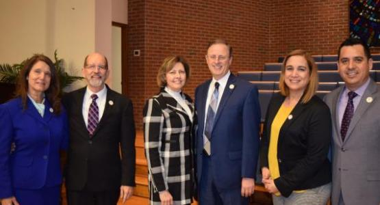 Conference officers re-elected pose with their wives at the constituency session: Will Peterson, executive secretary, and his wife, Darlene (left); Gary Gibbs, president, and his wife, Sherilyn (center); and Carlos Charnichart, treasurer, and his wife, Liz (right).