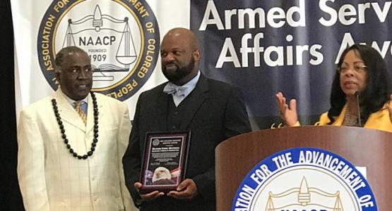 Richard Matthews (center) receives a NAACP award.