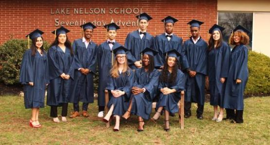 The first LNAA high school graduating class: (left to right) Karissa Osorio, class secretary*; Tania Tumundo, class treasurer*; Daniel Colón; Brendan Sierra, Student Association sports coordinator*; Juan Fernandez; Lyden Stanislaus-Niles, Student Association treasurer; Elinihaki Ngoye; Jenny Pontarelli, class vice president*; Taylore Williams; (sitting) Bethany Washburn; Naomie Charles, Student Association president*; Graciela Gonzales, class president* (Antonio Bermudez, not pictured) *NHS