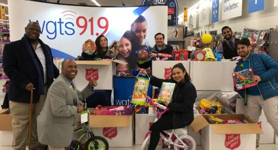 The WGTS 91.9 Community Engagement Team celebrates a successful toy collection.
