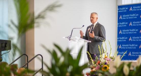 Erik Wangsness, president of WAH, speaks at the dedication of the new Adventist HealthCare White Oak Medical Center. Photo by Eli Turner