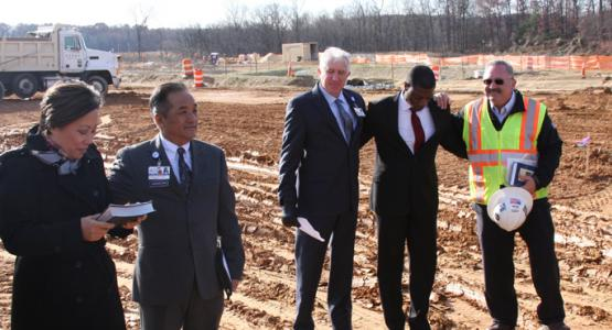 Anne Roda, vice president of Mission Integration & Spiritual Care, Adventist HealthCare; Chaplain Biaka Chhangte, Adventist HealthCare; Geoff Morgan, vice president of Expanded Access, Washington Adventist Hospital; Dwain Esmond; and Joe Kranz, project executive for Turner Construction, at ceremony marking the start of foundation work on the new WAH campus in White Oak, Maryland. Photo: Adventist HealthCare