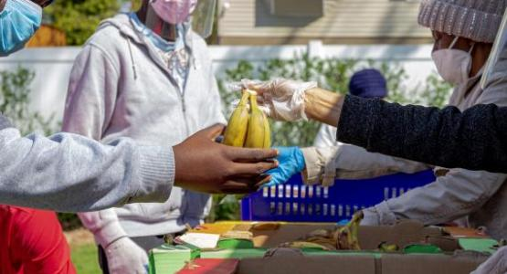 Volunteers distribute food at the food pantry at Allegheny East Conference's Church of the Oranges. Photo by Stuart Richardson