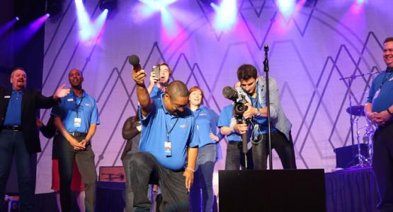 1. The WGTS 91.9 team records the audience singing the jingle. Left to right – PM Drive Host Johnny Stone; AM Drive Host Jerry Woods; Traffic anchor Tom Miner; PD Brennan Wimbish, Midday host Becky Alignay, Music Director Rob Conway; Video director Eugene Simonov and General manager Kevin Krueger.