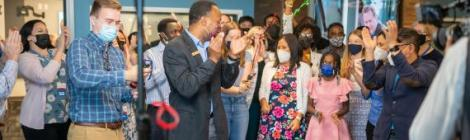 WGTS listeners and staff cheer as the new station goes live