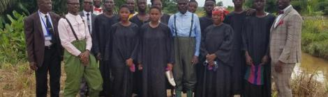 Emmanuel Aseidu (pictured right) gathers with baptismal candidates and church leaders in Ghana