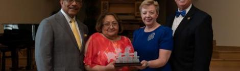 Claudio and Pamela Consuegra (right) presented the NAD Distinguished Service Award for Family Ministry to Buford and Carmen Griffith (left) on Saturday, July 20, during the Adventist Conference on Family Research & Practice. Photo credit Darren Heslop, University Communication staff photographer