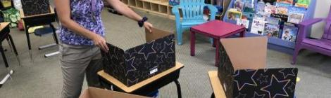 A teacher at Mt. Aetna Adventist School prepares her classroom for the upcoming year.